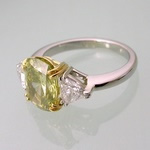 Yellow diamond platinum and gold ring with trapeze accents