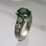 Chrome diopside and diamond platinum engagement ring