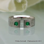 Engraved, open platinum gents ring with emeralds