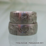 Platinum wedding bands with mirror pattern ancient celtic symbols