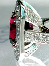 Halo red spinel diamond ring, in platinum