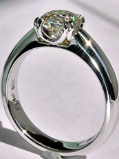 Square hearts and arrows diamond, in a custom designed platinum ring